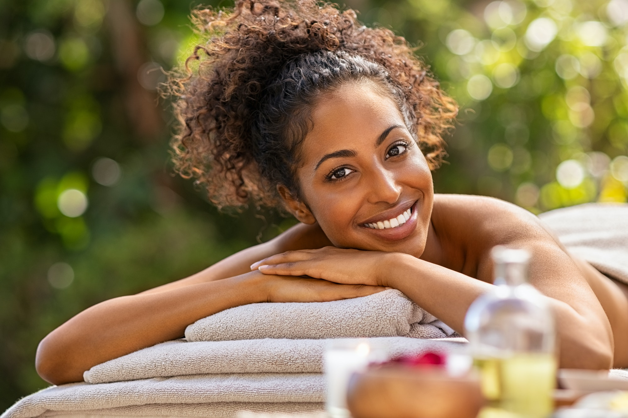 Happy african woman in resort spa