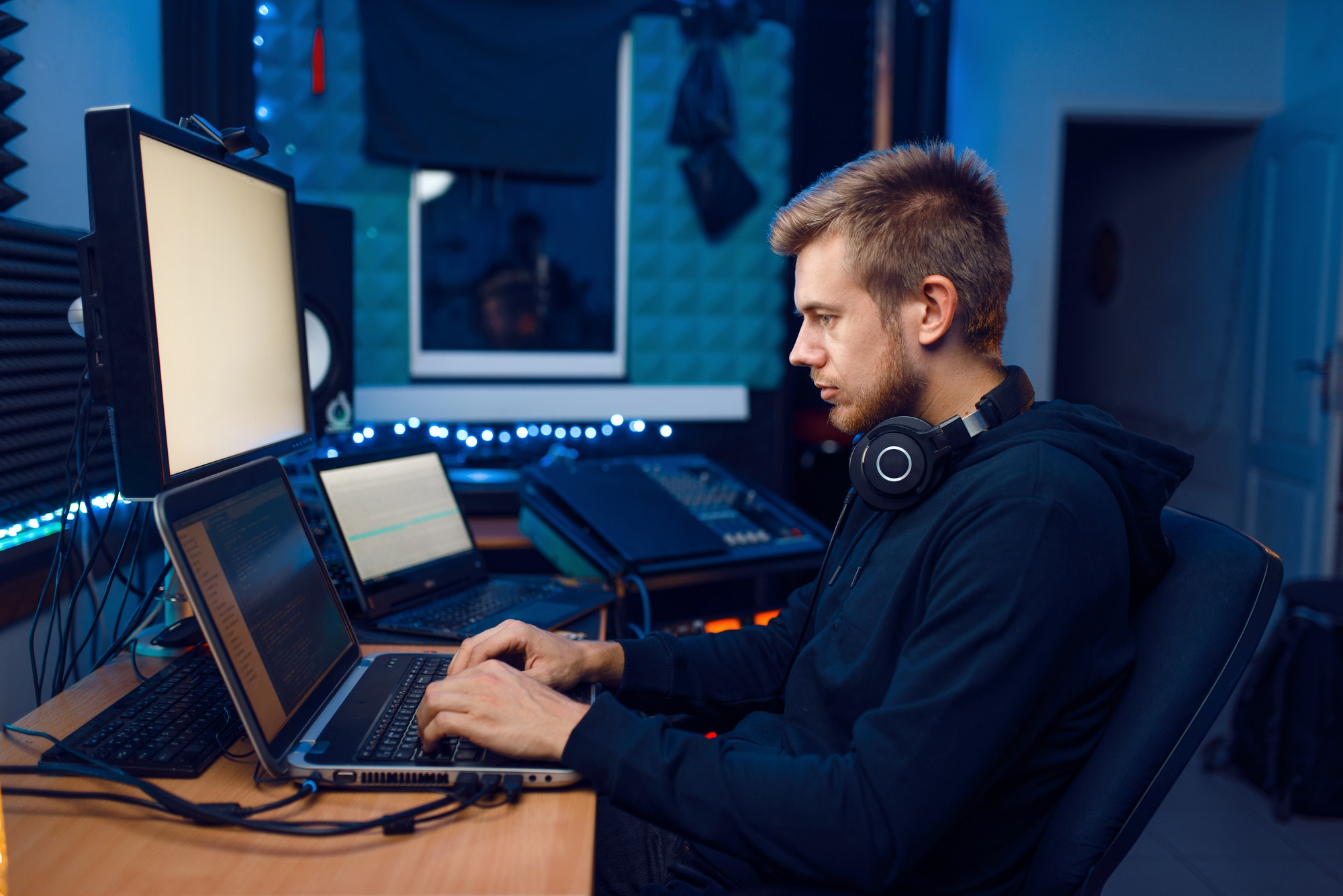 Programmer working on laptop, computer technology
