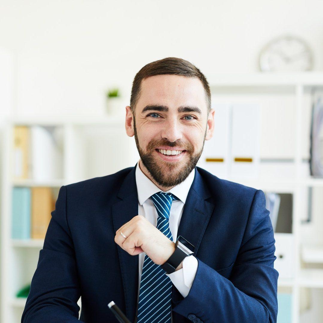 Happy CEO at desk