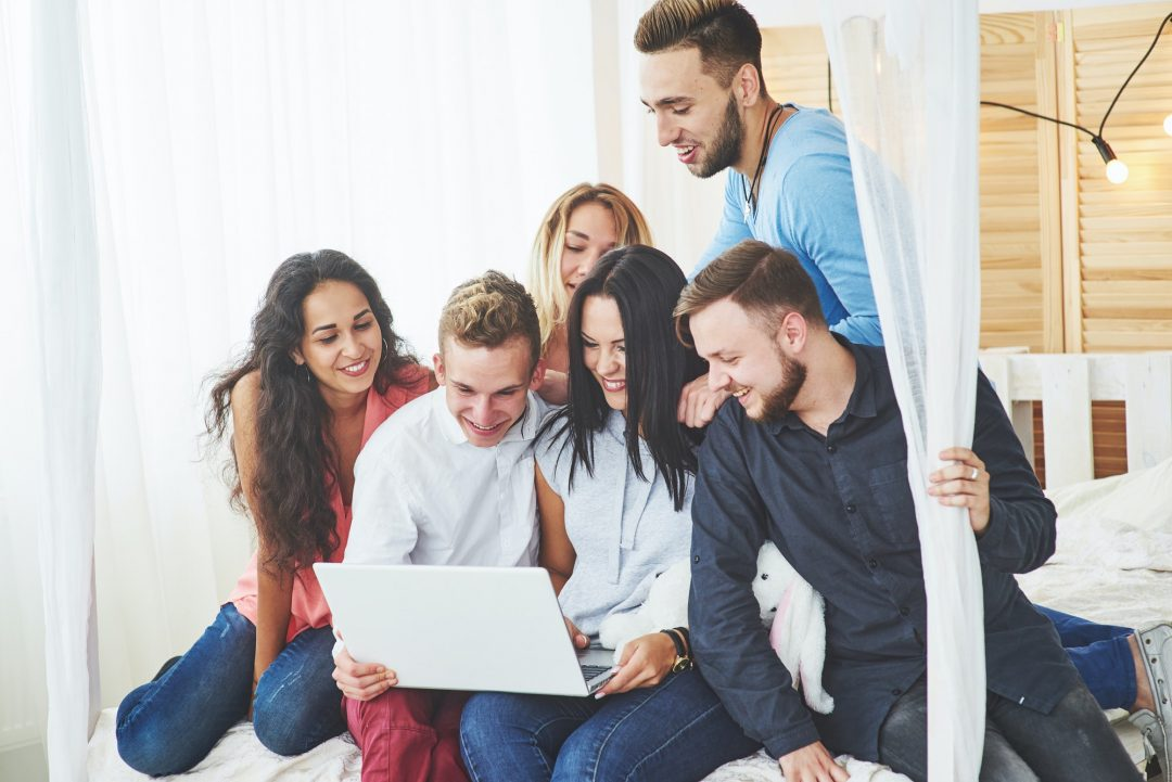 Group of creative young Friends Hanging Social Media Concept