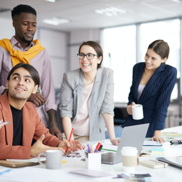 smiling-creative-team-working-in-office.jpg